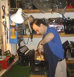Emilio Allodi repairing an accordion in his workshop